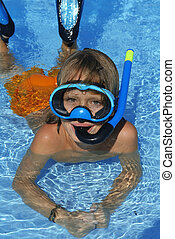 happy kid swimming with snorkel on summer holiday vacation