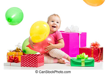 Happy kid with colorful balloons and gifts. Isolated on white.