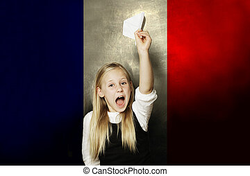 Happy kid with plane against France flag background. Learning French concept