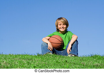 happy kid with sports basketball