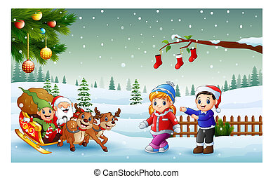 Happy kids and santa claus with elf riding on a sleigh with bag of gifts pulled by reindeer