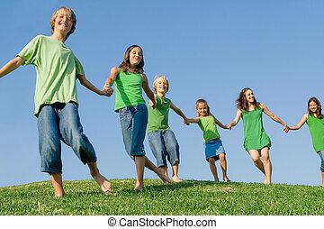 happy kids  - happy healthy lifestyle kids walking on hill