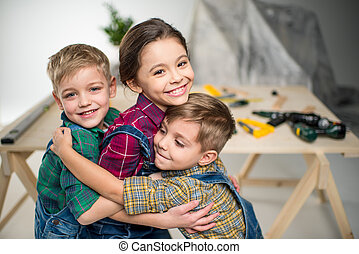Happy kids hugging