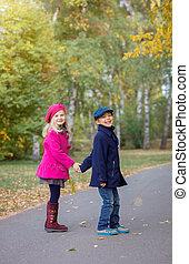 Happy Kids in Autumn Park