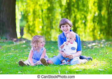 Happy kids in the garden - Three happy kids, brothers and...
