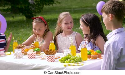 happy kids on birthday party at summer garden
