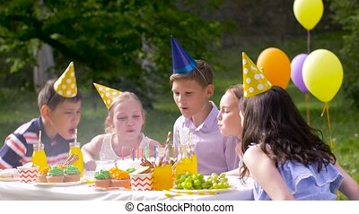 happy kids on birthday party at summer garden - holidays,...