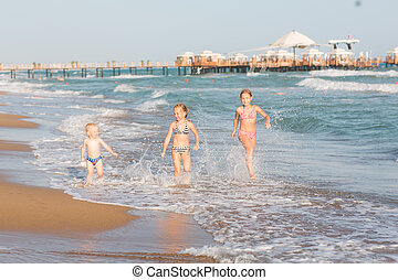 Happy kids on the beach