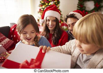 Happy kids opening Christmas presents