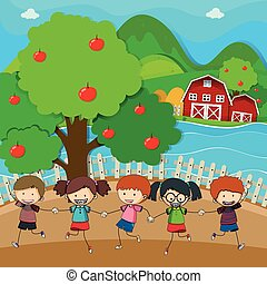 Happy kids playing in the apple orchard