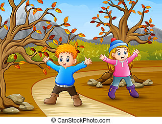 Happy kids playing in the autumn park