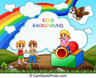 Happy kids playing in the playground with rainbow background