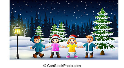 Happy kids playing in winter landscape at night