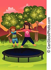 Happy kids playing on a trampoline
