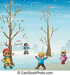 Happy kids playing outdoors in winter landscape