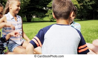 happy kids playing rock-paper-scissors game - summer ...