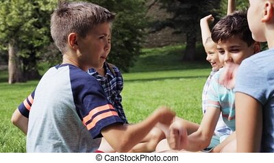 happy kids playing rock-paper-scissors game - summer...