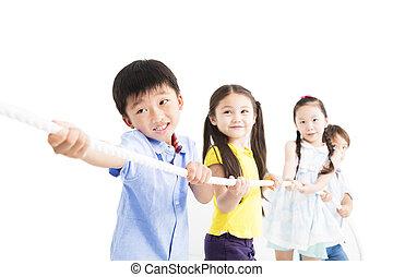 happy Kids playing tug of war