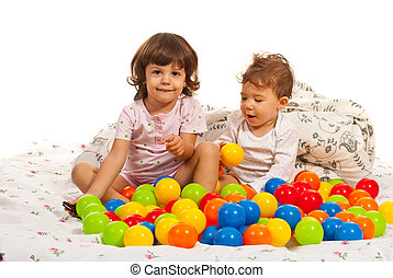 Happy kids playing with many balls