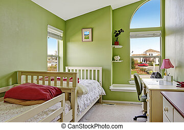 Happy kids room in bright green color. Furnished with two ...