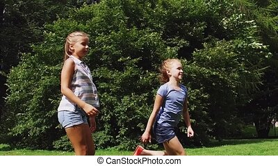 happy kids running and playing tag game outdoors