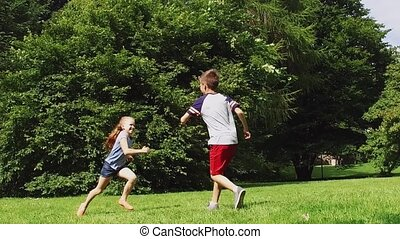 happy kids running and playing tag game outdoors - summer...