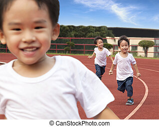 happy kids running on the Stadium track