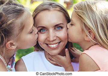 Happy kids sharing love to mother