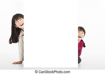 happy kids showing blank billboard