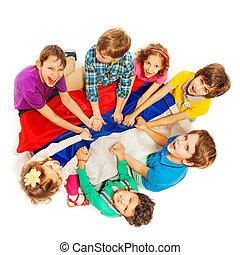 Happy kids sitting in a circle with flag of Russia