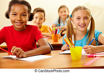 Happy kids - Portrait of lovely girls looking at camera at...