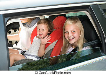 Happy Kids Traveling By Car