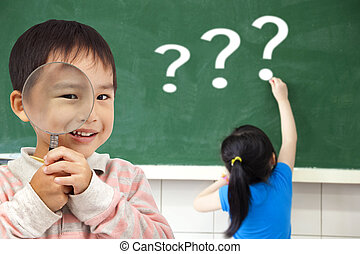 happy kids with drawing question mark in the classroom