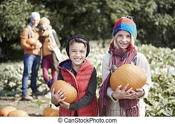 Happy kids with Halloween pumpkins