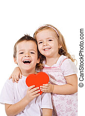 Happy kids with red heart