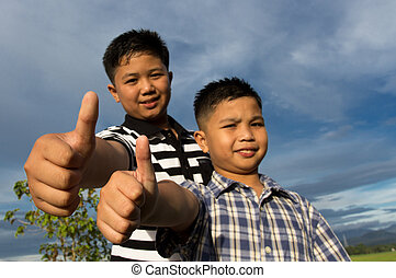 Happy kids with thumbs-up gesture