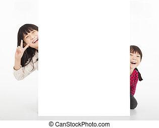 happy kittle girls showing blank billboard