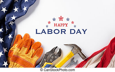 Happy Labor day concept. American flag with different construction tools on white background, with copy space for text.