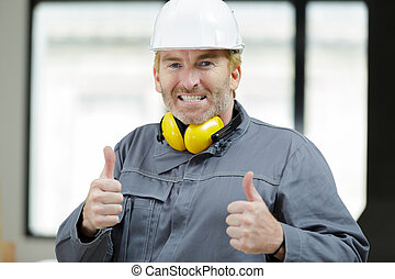 happy laborer showing okay sign