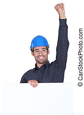 Happy laborer with fist up in the air