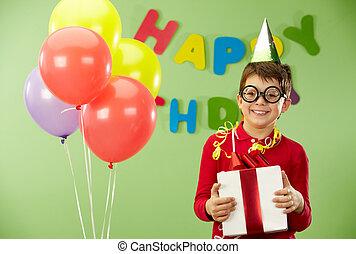 Happy lad - Portrait of happy lad in funny eyeglasses on...