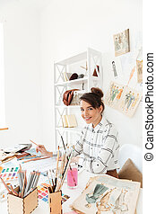 Happy lady fashion illustrator drawing