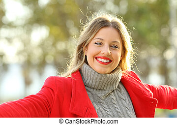 Happy lady posing looking at camera in winter