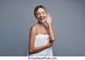 Happy lady putting one hand to the ear and smiling -...