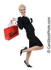 happy lady with shopping bag on isolated background