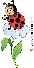Happy ladybug on flower image 1
