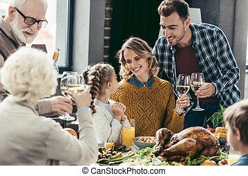 family having holiday dinner