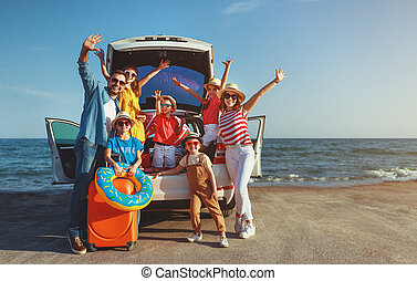 happy large family in summer auto journey travel by car on ...