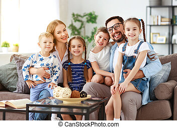 happy large family mother father and children at home