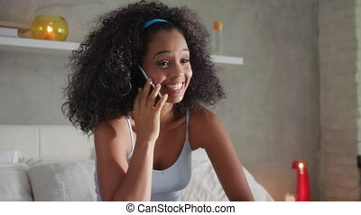 Happy Latina Teen With Pregnancy Test Kit And Telephone